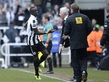 Papiss Cisse celebrates with manager Alan Pardew after grabbing the winner against Fulham on April 7, 2013