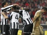 Newcastle players congratulate Papiss Cisse after his goal against Benfica on April 4, 2013