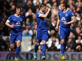 Phil Jagielka celebrates with team mates Kevin Mirallas and Leighton Baines after scoring the equaliser against Spurs on April 7, 2013