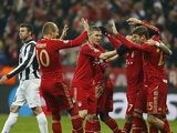 Bayern's Thomas Mueller is congratulated by team mates after scoring his team's second against Juventus on April 2, 2013