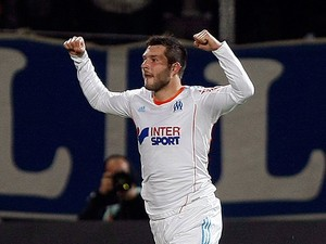 Marseille's Andre-Pierre Gignac celebrates scoring the opening goal against Bordeaux on April 5, 2013