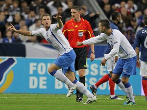 Bosnia's Edin Dzeko is congratulated by team mate Miralem Pjanic after scoring on October 12, 2011