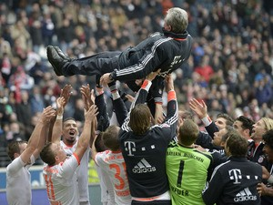 Bayern Munich coach Jupp Heynckes is thrown into the air after Bayern Munich sealed the Bundesliga title on April 6, 2013