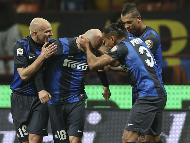 Inter Milan forward Tommaso Rocchi celebrates with his teammates after scoring against Atalanta on April 7, 2013