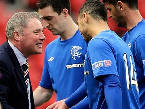 Rangers boss Ally McCoist congratulates his player Kane Hemmings after scoring against Queens Park on April 7, 2013