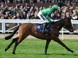 Mon Mome ridden by jockey Aidan Coleman goes to post before the JLT Specialty Handicap Chase on March 13, 2012
