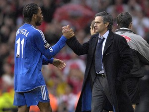 Chelsea manager Jose Mourinho and Didier Drogba embrace after winning the League Cup on February 25, 2007