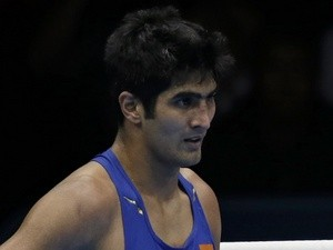 Indian boxer Vijender Singh reacts to losing a bout at the London Olympics on August 6, 2012
