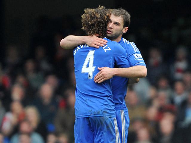 Branislav Ivanovic is hugged by team mate David Luiz after scoring his team's second against Sunderland on April 7, 2013