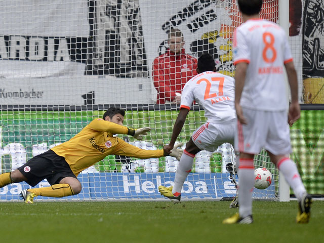 Bayern Munich's David Alaba misses a penalty during his side's match with Eintracht Frankfurt on April 6, 2013