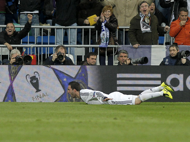 Real Madrid's Gonzalo Higuain celebrates scoring his side's third goal in their match against Galatasaray on April 3, 2013