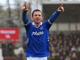 Portsmouth's David Connolly celebrates after scoring the equaliser against Brentford on April 13, 2013