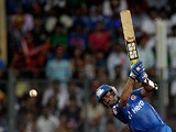 Mumbai Indians' Dinesh Karthik in action on May 9, 2012