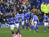 Everton players celebrate their second goal in the Premier League match against QPR on April 13, 2013