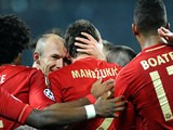 Bayern's Mario Mandzukic is congratulated by team mates after scoring the opening goal against Juventus on April 10, 2013