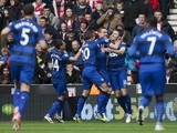 United players congratulate Michael Carrick after a goal against Stoke on April 14, 2013