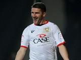 MK Dons player Ryan Lowe celebrates scoring against Swindon Town on April 9, 2013