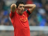Liverpool's Luis Suarez holds his head in his hands after a missed chance during the match against Reading on April 13, 2013