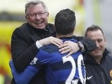 United striker Robin Van Persie celebrates with Sir Alex Ferguson after scoring a penalty against Stoke on April 14, 2013