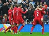 Wigan's Shaun Maloney is congratulated by teammates after scoring the opening goal against Millwall on April 13, 2013
