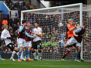 Aston Villa's Fabian Delph scores an own goal in the match against Fulham on April 13, 2013