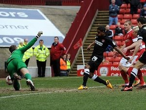Charlton's Bradley Pritchard scores the opener in the match against Barnsley on April 13, 2013