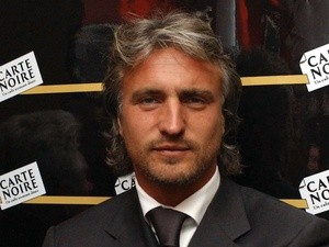 David Ginola arrives at an awards ceremony in London on April 2, 2003