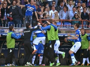 Sampdoria players celebrate a goal by Eder against Genoa on April 14, 2013