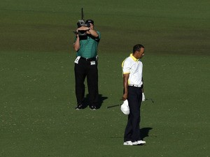 Tiger Woods after his fairway shot on the 15th hole hit the pin and rolled into the water on April 12, 2013