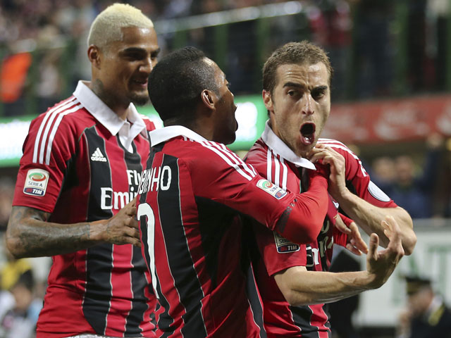 AC Milan midfielder Mathieu Flamini celebrates after scoring against Napoli during the Serie A clash on April 14, 2013