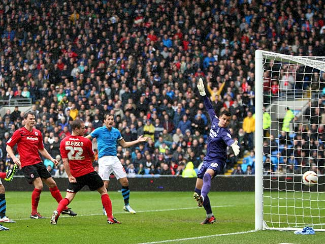 Cardiff's Heidar Helguson heads in the opening goal in the match against Nottingham Forest on April 13, 2013