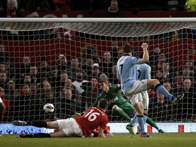James Milner opens the scoring for City against United on April 8, 2013