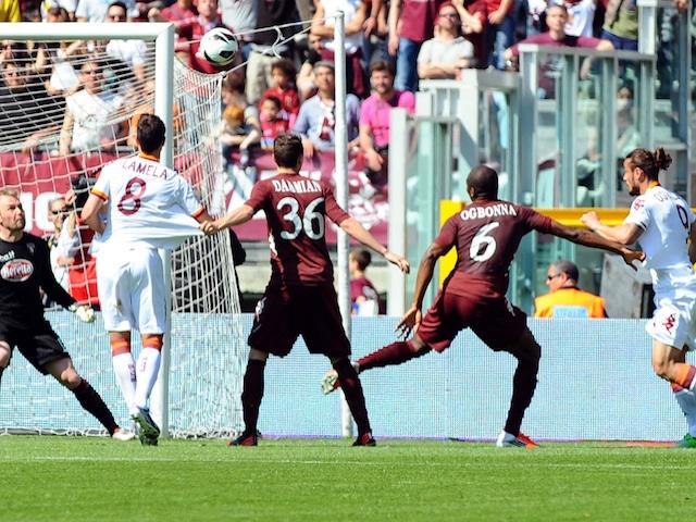 Roma's Pablo Osvaldo scores against Torino on April 14, 2013