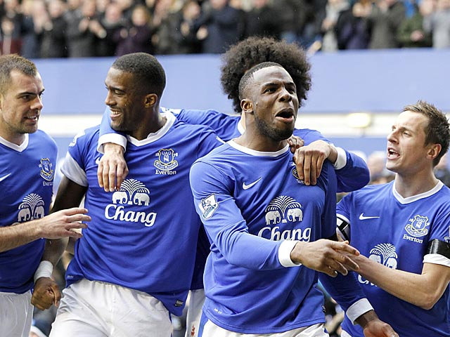 Victor Anichebe is congratulated by teammates after scoring his team's second against QPR on April 13, 2013