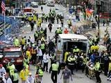 Medical workers aid injured people following explosions at the Boston Marathon on April 15, 2013