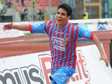 Catania midfielder Pablo Barientos celebrates after scoring against Palermo on April 21, 2013