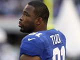 Justin Tuck of the New York Giants stands on the sideline during the NFL match with the Dallas Cowboys on October 28, 2012