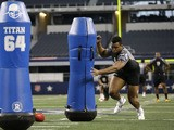 British Olympian Lawrence Okoye participates in a defensive ends position drill during the NFL super regional football combine on April 7, 2013