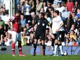 Arsenal's Olivier Giroud is shown a straight red card in a game against Fulham on April 20, 2013