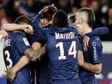 Paris Saint Germain's Zlatan Ibrahimovic is congratulated by teammate's after scoring against OGC Nice on April 21, 2013