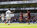 Manchester City's Samir Nasri scores against Tottenham Hotspur in the Premier League match on April 21, 2013