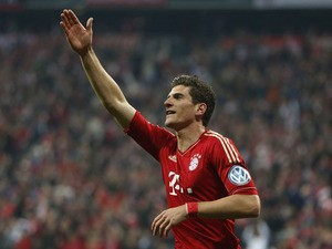 Bayern's Mario Gomez celebrates after scoring during the German Cup semi final against Wolfsburg on April 16, 2013