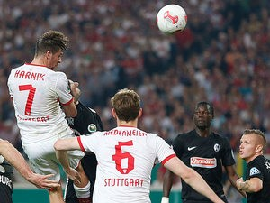 Stuttgart's Martin Harnik heads in his team's second against Freiburg on April 17, 2013