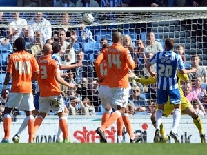Brighton's Matt Upson scores against Blackpool on April 20, 2013
