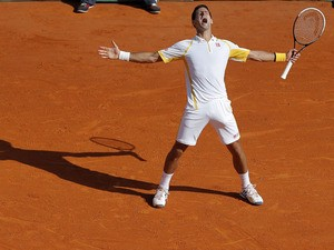 Novak Djokovic celebrates beating Rafael Nadal in the final of the Monte Carlo Tennis Masters on April 21, 2013