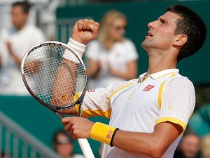 Novak Djokovic punches the air after defeating Mikhail Youzhny during the Monte Carlo Masters on April 17, 2013