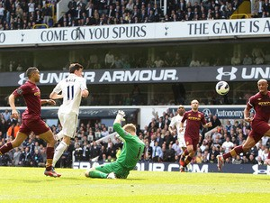 Tottenham Hotspur's Gareth Bale scores his side's third goal in the match against Manchester City on April 21, 2013