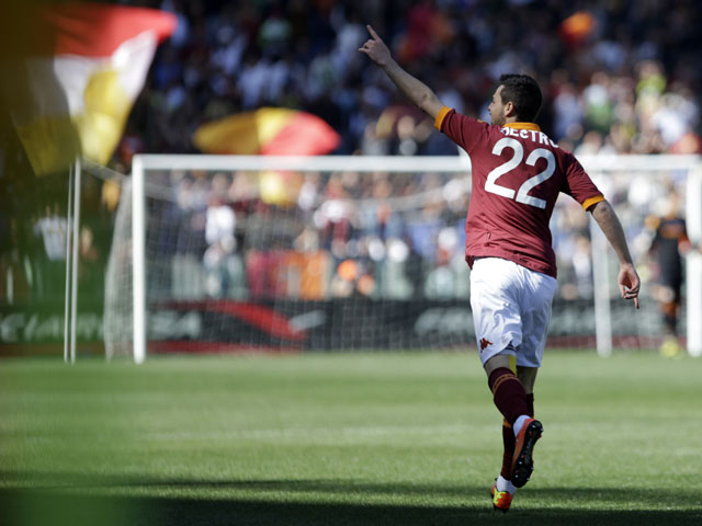 AS Roma forward Mattia Destro celebrates after scoring agasint Pescara on April 21, 2013