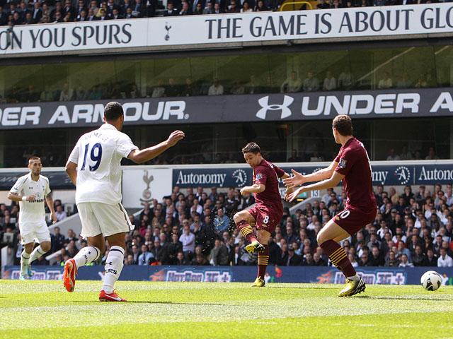 Manchester City's Samir Nasri scores against Tottenham Hotspur in the Premier League match on April 21, 2013