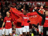 Manchester United players celebrate winning the Premier League title on April 22, 2013
